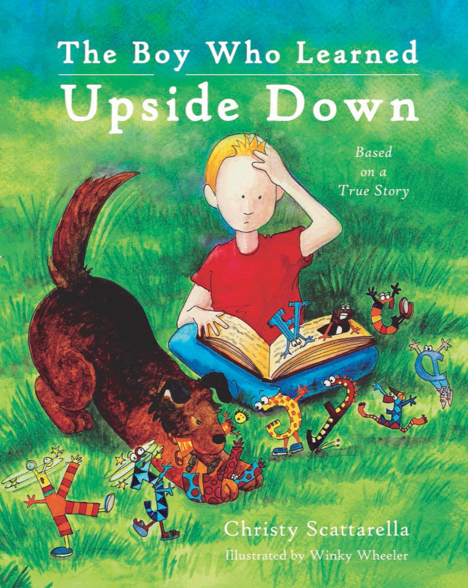 cover of The Boy Who Learned Upside Down boy in meadow with this dog