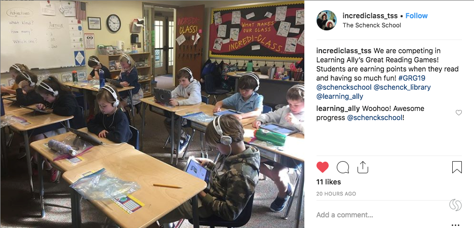 Instagram photo of The Schneck School classroom. Students reading audiobooks intently.