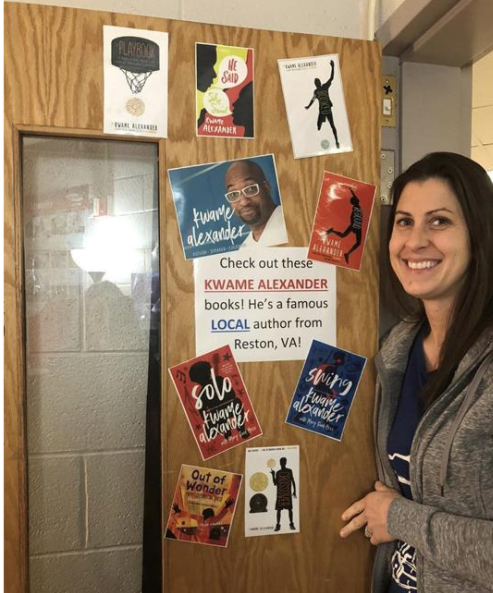 Virginia Teacher Katherine York standing at her classroom door with pictures of author Kwame Alexander.