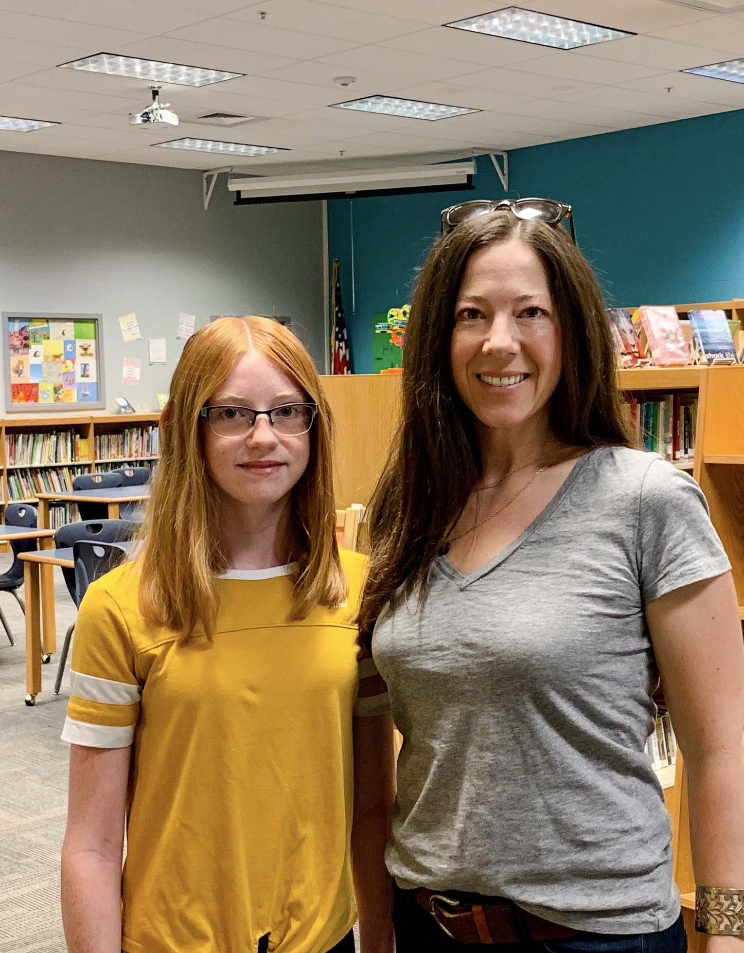 Ms. Davis and student, Brooke in a classroom