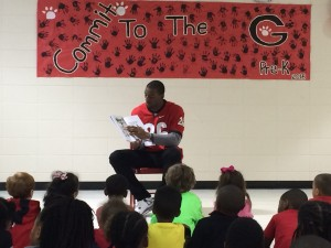 Malcolm in Jersey Reading to Kids