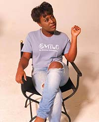 Mojena Sitting on a Director's Chair