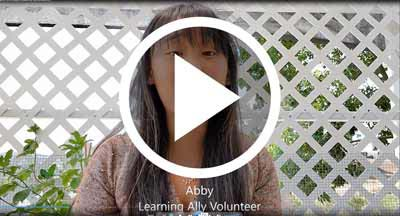 Video of Volunteer sharing a positive word with our students