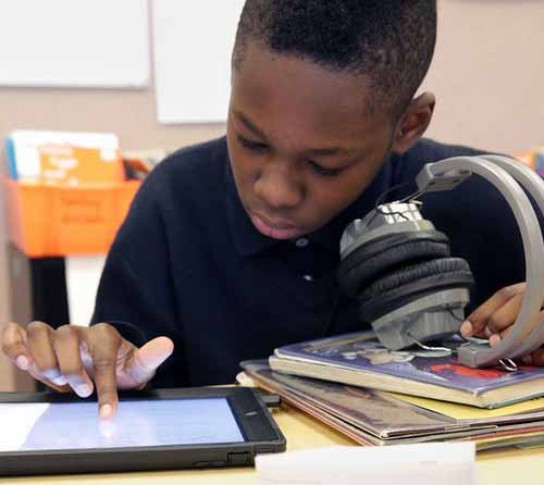 student reading with tablet