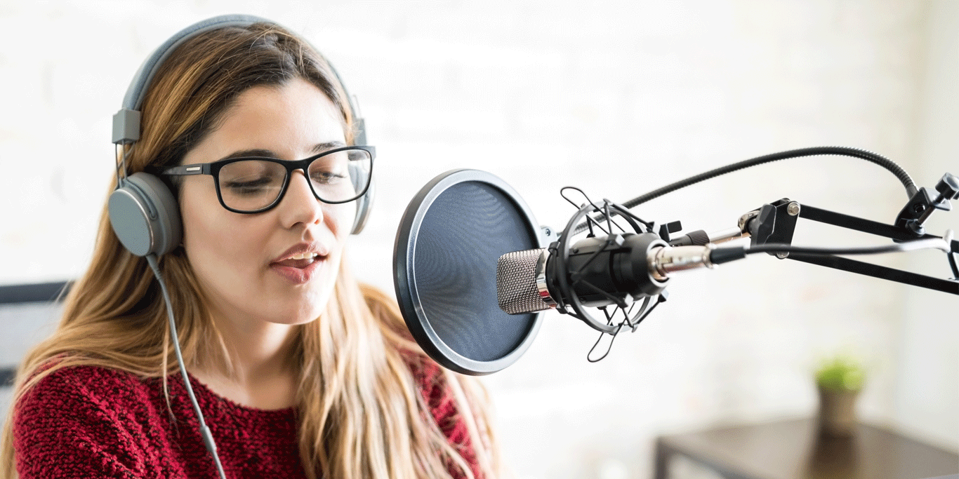 Woman recording into a microphone